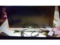 DM Tech TV PC Monitor. Brand New. Remote control. Collect today cheap