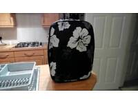 Black and white suitcase on wheels