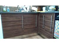 Kitchen units - base, wall and full height cupboards. Cream and brown