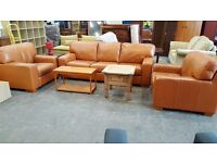 Large tan leather three seater and two matching armchairs