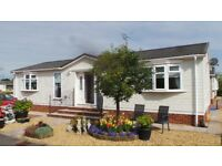 A stunningly attractive RESIDENTIAL park home bungalow Scottish Borders OFFERS OVER £95,000