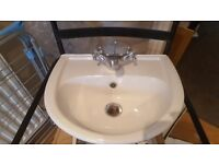 Secondhand white cloakroom basin.