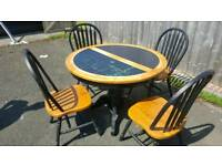 Good solid table and 4 chairs