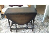 Solid dark wood drop leaf dining/occasional table in great condition