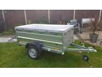 New Car Box Camping trailer with extensions sides and flat cover.