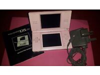 Pink Nintendo DS Lite with UK plug charger and instruction booklet