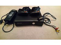 XBOX 360 console, 1 wireless controller and one with a cable