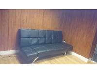 Sofa-cum-bed in black leatherite for collection from basement floor