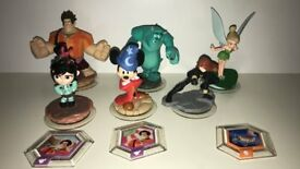 24 disney infinity characters and 7 discs
