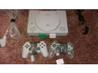 Sony PS1 console , with leads, two mem cards and 2 dual shock controllers