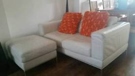 Cream/off-white leather sofa and foot stool
