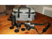 Canon AV-1 35mm camera with 3 lenses and case
