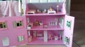 Wooden dolls house, furnitur and dolls. Used but clean and from smoke free home.