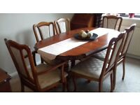 Dining room table, 4 chairs & 2 carvers plus sideboard.
