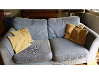 2 sofas- (one blue; one yellow)
