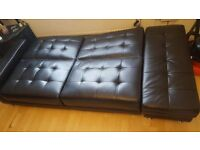 Wonderful black leather sofa/bed
