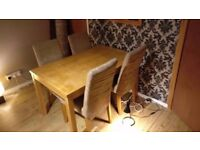 Solid wooden table and comfortable suede like comfy chairs, washable