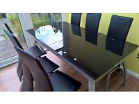 Glass dining table plus six chairs