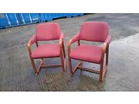 Two comfortable reception chairs, wood trim and fabric upholstery