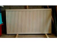 CENTRAL HEATING RADIATOR (double sided) c/w THERMOSTATIC VALVE. L = 110cm, H = 60cm, D = 10cm