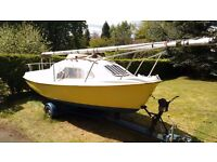 Skipper 17 Trailer Sailer. Good condition. Twin retractable keels.