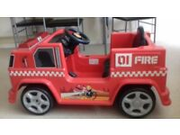 Electric fire engine,mint condition,lights and sounds