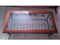 Coffee table glass wood top, coast iron bottom exellent condition
