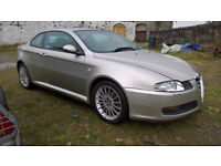 2004 light green Alfa Romeo GT JTS 2.0 (petrol) with under 65K miles.