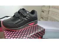 Brand new kids black and pink trainers