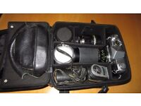 Yashica Penta SLR camera with several lenses, light meters and bag