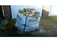 1 ton bag filled with seasoned logs