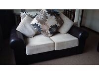Great condition 2 and 3 seater couches, brown leather and cream floral print fabric