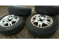 Set of alloys wheels with nearly new tires for Punto etc.. 165 / 70 / 14