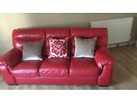 Red leather sofa 3 & 2 seater with pouffy