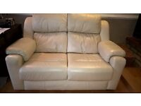 Cream leather 2 seater sofa, chair and foot stool.