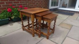 Nest of tables in solid oak with barleytwist legs. Excellent condition.