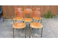 5 x wood and metal chairs.