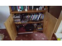 wooden tall ikea bookcase with two doors
