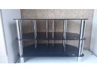 universal black glass and hrome legs tv stand