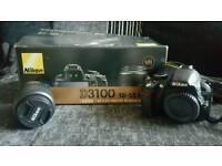 D3100 Nikon DSLR with 18-55mm lens