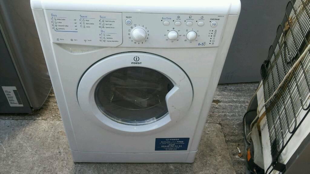 White Indesit washer dryer.