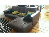 Very good condition dark brown leather sofa