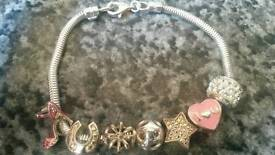 Silver bracelet with 7 charms