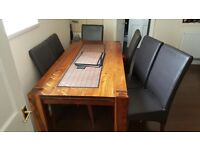 Solid wood dinning table and 6 leather chairs