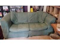 Very comfortable couch with removable green and red covers
