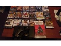 ps2 wth 2 controles and selection of games