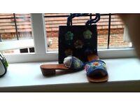 Matching woman's sliders and handbag