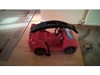 little tikes push along car, folds down to fit in car boot, lots of storage.