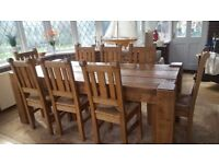 Custom built rustic dining table in solid pine seats 8: with 8 matching chairs.