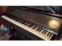 FREE dark wood upright piano. Very out of tune, possibly beyong being used properly as an instrument